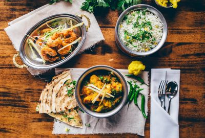 Flat lay of table laden with dishes cooked from Indian restaurant Merchant City Glasgow The Dhabba