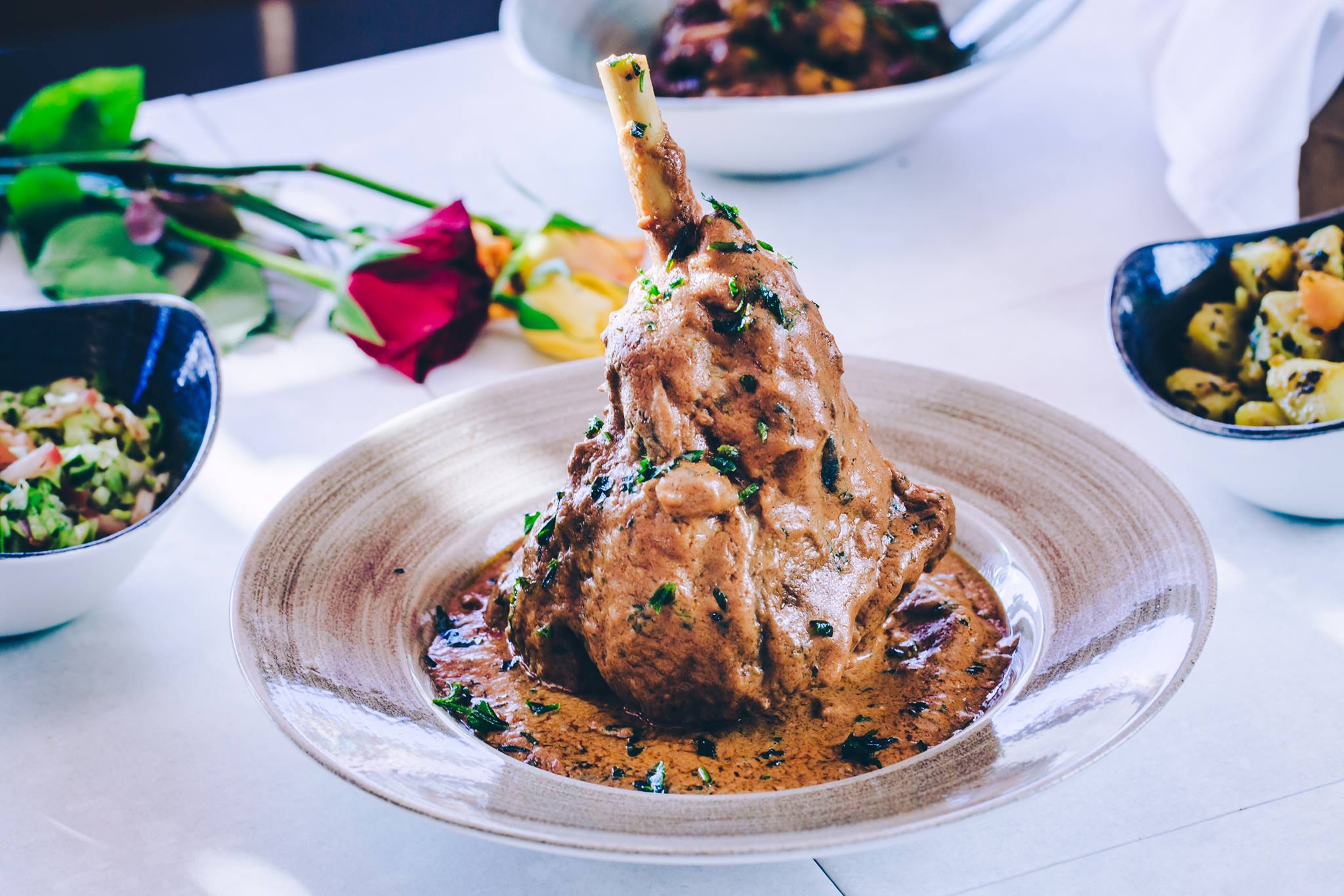 Raan-e-Sikandari leg of lamb with dark rum herbs and spices, a dish from Indian Restaurant Merchant City Glasgow