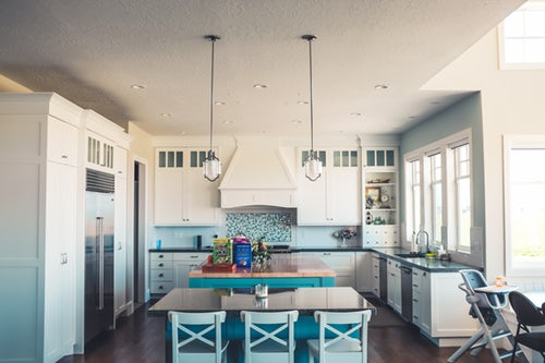 Beautiful kitchen with double door fridge and blue finishing within luxury home